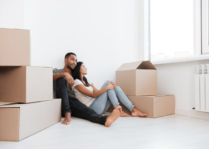 couple relaxing after moving into their new home
